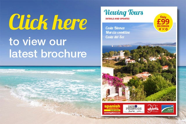 Viewing trip brochure with Spanish Legal Homes
